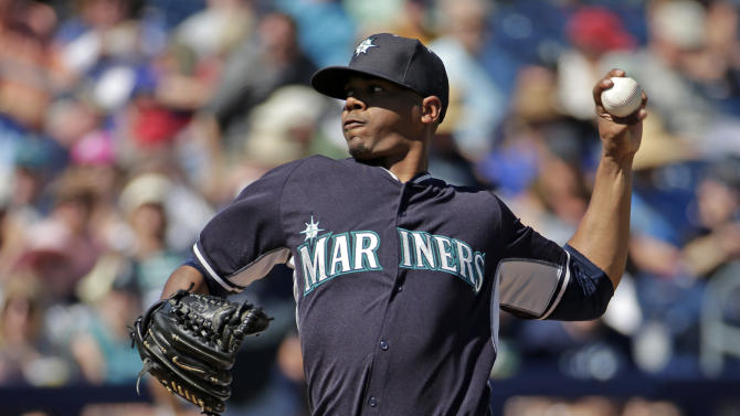 Seattle Mariners starting pitcher Roenis Elias throws during the second inning of a spring training baseball game against the San Diego Padres Thursday, March 5, 2015, in Peoria, Ariz. (AP Photo/Charlie Riedel)
