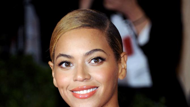 FILE - This May 7, 2012 file photo shows Beyonce Knowles at the Metropolitan Museum of Art Costume Institute gala benefit, celebrating Elsa Schiaparelli and Miuccia Prada in New York. Beyonce called for a moment of silence for Trayvon Martin during a concert just hours after George Zimmerman was found not guilty by a Florida jury, Saturday, July 13, 2013 in Nashville, Tenn. (AP Photo/Evan Agostini, File)