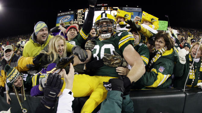 FILE - This Nov. 14, 2011 file photo shows Green Bay Packers' John Kuhn celebrateing with fans after catching a touchdown pass during the second half of an NFL football game against the Minnesota Vikings,  in Green Bay, Wis. Wear those Cheeseheads proudly, Packers fans. Your team leads the first-ever AP Pro32 NFL power rankings, a new pro football version of the AP Top 25 college football and basketball polls.  (AP Photo/Morry Gash, File)