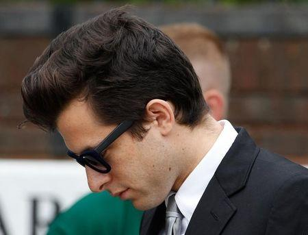 Music producer Mark Ronson leaves the funeral service for Amy Winehouse at a cemetery in north London