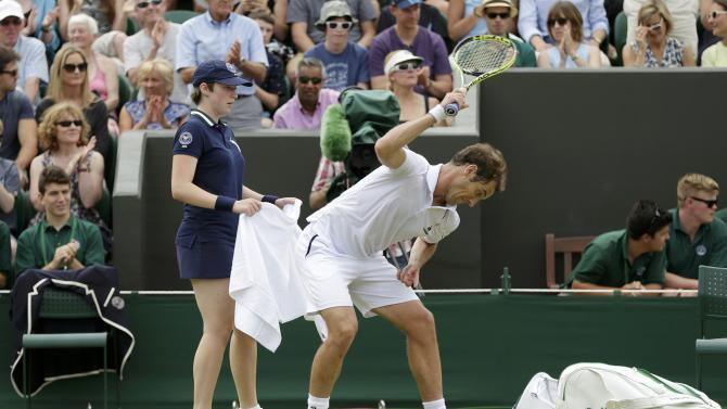 Richard Gasquet of France smashes his racket after losing the third set during his match against Nick Kyrgios of Australia at the Wimbledon Tennis Championships in London