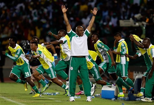 In this Feb. 3 2013 file photo, Nigeria's head soccer coach Stephen Keshi, center, reacts to the final whistle of their African Cup of Nations quarterfinals match with Ivory Coast at the Royal Bafoken