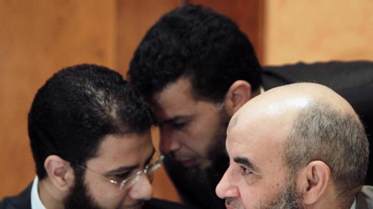 Nour party spokesman Bakkar, chats with a party member next to Makhyoun, the head of the party, during a news conference about constitution in Cairo