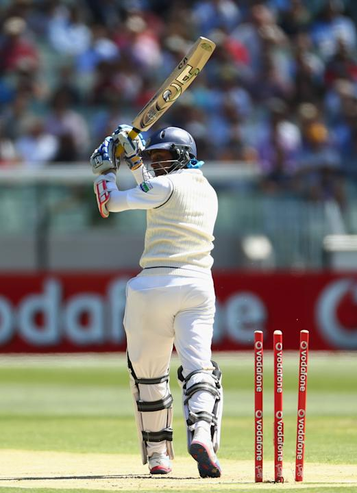 Tillakaratne Dilshan of Sri Lanka is bowled by Mitchell Johnson of Australia during day one of the Second Test match between Australia and Sri Lanka at Melbourne Cricket Ground on December 26, 2012 in