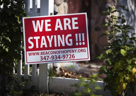 A sign is pictured in front of a house in the New Dorp Beach area in the Staten Island borough of New York
