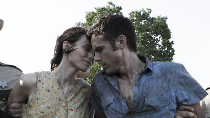 "This undated publicity photo provided by the Sundance Institute shows Rooney Mara, left, and Casey Affleck, right, in a scene from the film, ""Ain't Them Bodies Saints,"" included in the U.S. Dramatic Film competition at the 2013 Sundance Film Festival. (AP Photo/Sundance Institute, Steve Dietl)"