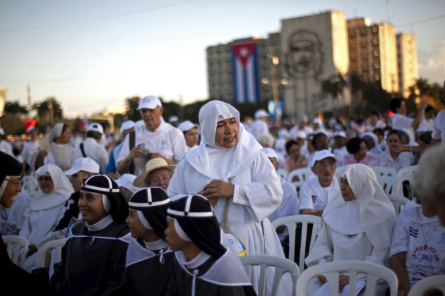 Nuns wait as worshippers gather in Revolution Square for the arrival of the Pope Benedict XVI  to celebrate a Mass in Havana, Cuba, Wednesday, March 28, 2012. Pope Benedict XVI wraps up his visit to C