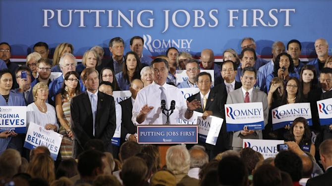 This photo taken  June 27, 2012, shows Republican presidential candidate Mitt Romney campaigning with Virginia Gov. Bob McDonnell at Electronic Instrumentation and Technology in Sterling, Va. Before the election of President Barack Obama, Virginia, a two-party state in down-ballot races, had not sided with Democrats on the presidency since Lyndon Johnson in 1964. Jimmy Carter in 1976 was the last Democratic nominee to win North Carolina. Each state is in play again, with Romney needing to reclaim Florida and at least one of the others to reach the White House. (AP Photo/Charles Dharapak)