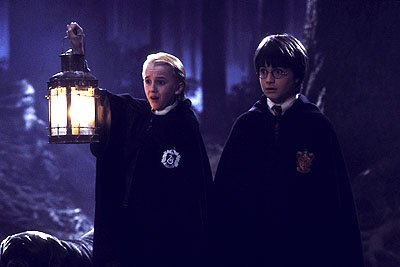 Tom Felton as Draco Malfoy and Daniel Radcliffe as Harry Potter in Warner Brothers' Harry Potter and The Sorcerer's Stone