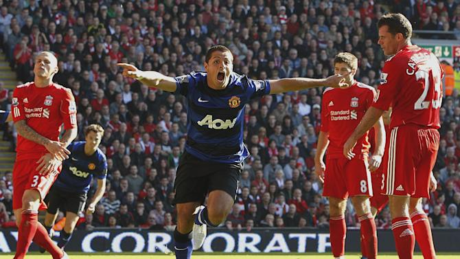 Manchester United's Javier Hernandez, center, celebrates after scoring his team's opening goal against Liverpool during an English Premier League match at Anfield, Liverpool Saturday Oct. 15, 2011.  (AP Photo/Peter Byrne/PA Wire)  UNITED KINGDOM OUT