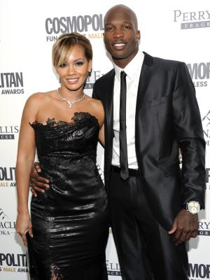 FILE - In this March 7, 2012, file photo, NFL football player Chad Johnson, right, poses with his fiancee, Evelyn Lozada, at an event in New York. Johnson was arrested Saturday, Aug. 11, 2012, on a domestic violence charge, accused of head-butting Lozada during an argument in front of their home outside Miami. Johnson and Lozada, now married, were at dinner and she confronted him about a receipt she had found for a box of condoms, said Davie police Capt. Dale Engle. The argument got heated and continued on the drive home, he said. (AP Photo/Evan Agostini, File)