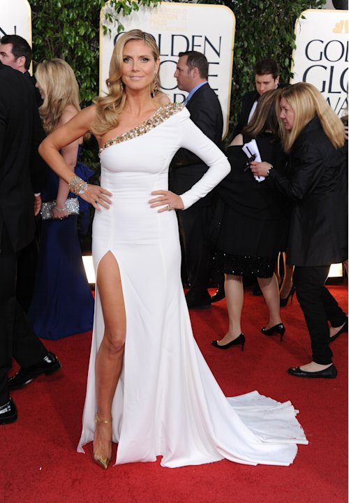 Model and TV personality Heidi Klum arrives at the 70th Annual Golden Globe Awards at the Beverly Hilton Hotel on Sunday Jan. 13, 2013, in Beverly Hills, Calif. (Photo by Jordan Strauss/Invision/AP)