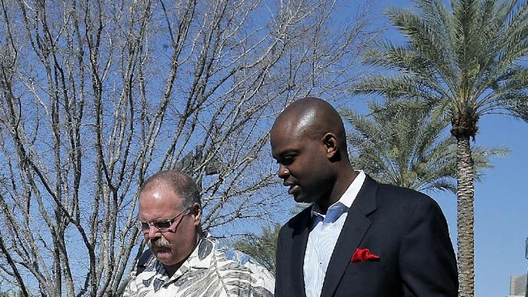 Kansas City Chiefs head coach Andy Reid, left, arrives for NFL football annual meetings at the Arizona Biltmore, Monday, March 18, 2013, in Phoenix. (AP Photo/Matt York)