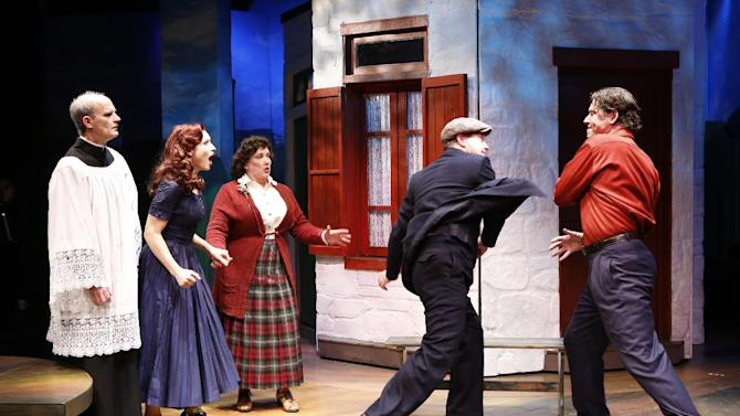 "This theater image released by Shirley Herz Associates shows, from left, David Sitler, Jenny Powers, Kathy Fitzgerald, Ted Koch and James Barbour, in a scene from the musical ""Donnybrook"", performing off-Broadway at the Irish Repertory Theatre in New York.  (AP Photo/Shirley Herz Associates, Carol Rosegg)"