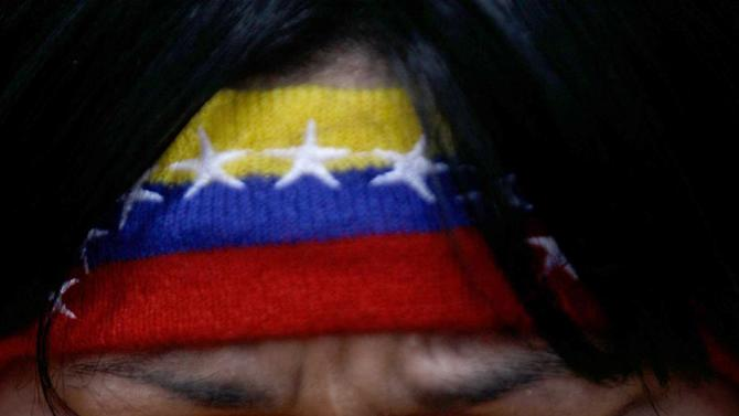"A woman reacts during a demonstration in support of Venezuela's President Hugo Chavez at the Simon Bolivar square in Caracas, Venezuela, Sunday Dec. 9, 2012. Chavez was heading back to Cuba on Sunday for more cancer surgery after announcing that the illness returned despite two previous operations, chemotherapy and radiation treatment.  Chavez said Saturday that if there are ""circumstances that prevent me from exercising the presidency further""  Vice-President Nicolas Maduro should replace him for the remainder of his term.(AP Photo/Fernando Llano)"