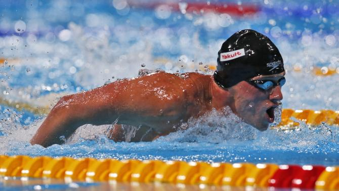 Ryan Lochte of the United States swims in the Men's 100m butterfly final at the FINA Swimming World Championships in Barcelona, Spain, Saturday, Aug. 3, 2013. (AP Photo/Michael Sohn)