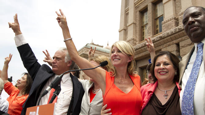 Democrat state senators, from left, Kirk Watson, Wendy Davis, Leticia Van de Putte and Royce West participate in a pro-abortion rights rally at the state Capitol in Austin, Texas, on Monday July 1, 2013. The Texas Senate has convened for a new 30-day special session to take up contentious abortion restrictions bill and other issues. (AP Photo/Statesman.com, Jay Janner)