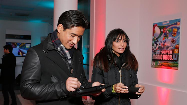 Mario Lopez, left, and Courtney Laine Mazza warm up and check out Wii U at the Nintendo Lounge while playing Super Mario Bros. U during a break from the Sundance Film Festival on Friday, January 18, 2013 in Park City, UT. (Photo by Todd Williamson/Invision for Nintendo/AP Images)