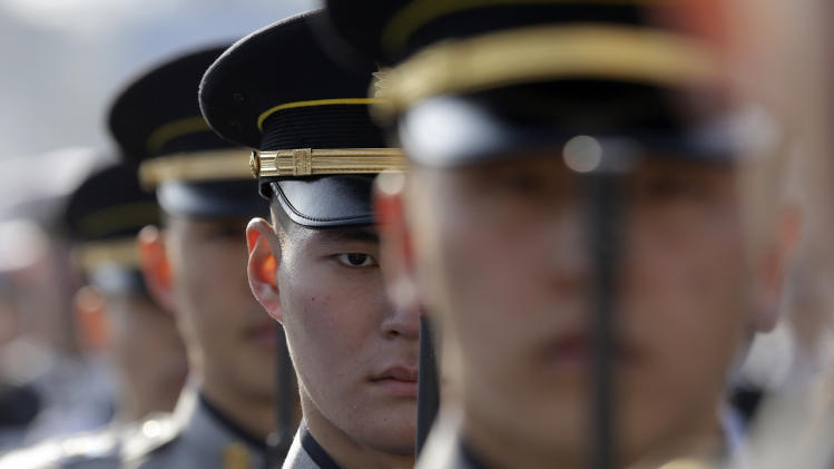 South Korean honor guards salute during a rehearsal of the 18th presidential inauguration ceremony  inside the National Assembly in Seoul, South Korea, Sunday, Feb. 24, 2013. The inauguration of South Korea's new President Park Geun-hye will be held on Feb. 25. (AP Photo/Lee Jin-man)