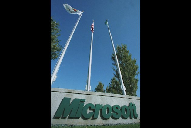 FILE - This set of flagpoles sits at one of the entrances to Microsoft Corporation in Redmond, Wash., in this Oct.19, 1998 file photo. The General Court of the European Union has upheld most of a massive fine against Microsoft Corp. by the European Commission&#39;s competition watchdog in 2008. In a ruling Wednesday, June 27, 2012, it rejected Microsoft&#39;s appeal but did cut the fine by 39 million to 860 million ($1.1 billion). (AP Photo/Joe Brokert, File)