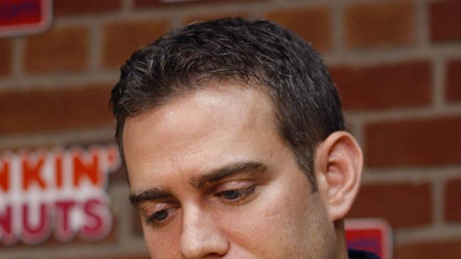 Boston Red Sox general manager Theo Epstein pauses as he speaks to the media during a news conference on Friday, Sept. 30, 2011, in Boston. In a joint statement released on Friday, the Red Sox announced they will not pick up the option on Terry Francona's contract in the wake of the team's September collapse. (AP Photo/Bizuayehu Tesfaye)