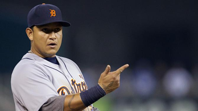 Detroit Tigers third baseman Miguel Cabrera (24) communicates with coaches during the first inning of a baseball game against the Kansas City Royals at Kauffman Stadium in Kansas City, Mo., Wednesday, Oct. 3, 2012. (AP Photo/Orlin Wagner)