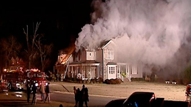 Family escapes from burning home