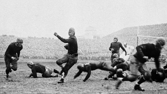 FILE - In this Nov. 27, 1927, file photo, Southern California's Morley Drury carries the ball against Notre Dame during an NCAA college football game at Soldier Field in Chicago. Notre Dame won 7-6 after a controversial call when an official ruled an apparent safety for Southern California was an incomplete pass. The Associated Press takes a look at some of the memorable games in college football's greatest intersectional rivalry in anticipation of Southern California hosting No. 1 Notre Dame on Saturday, Nov. 24, 2012. (AP Photo/File)