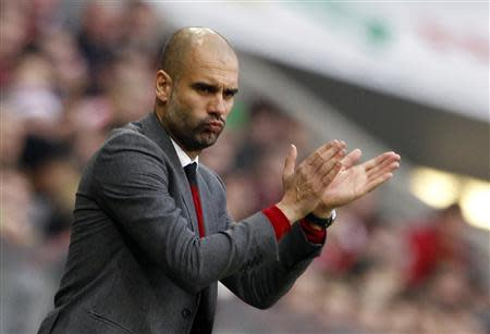 Bayern Munich's coach Pep Guardiola reacts during their German Bundesliga first division soccer match against Freiburg in Munich