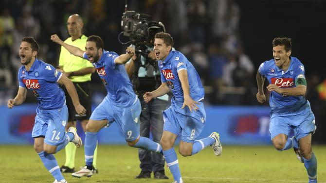 Napoli's players react after winning the penalty shoot-out during the Italian