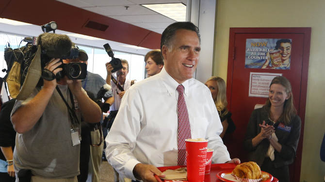 Former GOP presidential candidate Mitt Romney greets the lunch crowd at the Varsity, Wednesday, Oct. 1, 2014, in Atlanta. Romney attended a private fundraiser for Republican candidate for Senate David Perdue earlier. Romney is the Republican man in demand. The twice-defeated White House contender is campaigning across seven states in five days this week to raise money and energy for Republican midterm candidates. (AP Photo/John Bazemore)