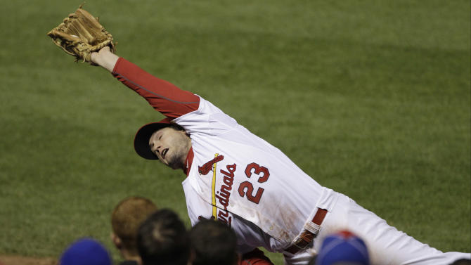 St. Louis Cardinals' David Freese catches a foul ball hit by Texas Rangers' Josh Hamilton during the fifth inning of Game 7 of baseball's World Series Friday, Oct. 28, 2011, in St. Louis. (AP Photo/Paul Sancya)