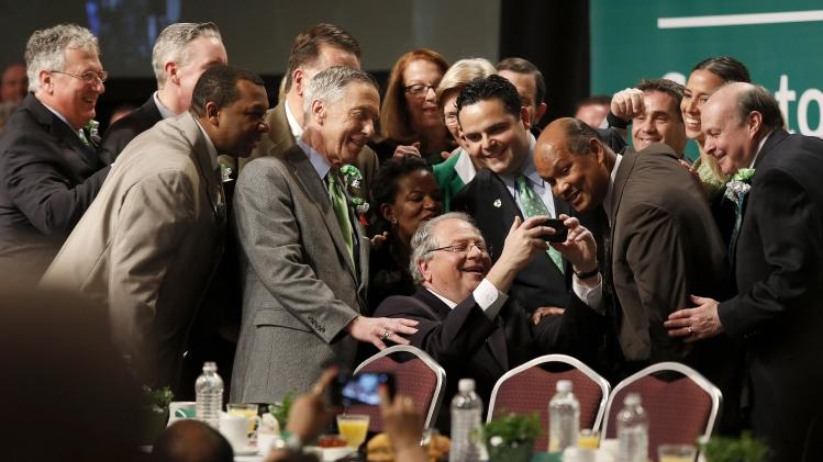 Massachsusetts State Speaker DeLeo gathers colleagues for a selfie at the annual St. Patrick's Day breakfast in Boston