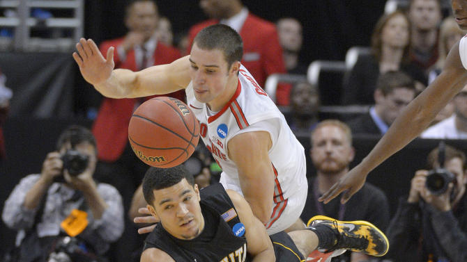 Ohio State guard Aaron Craft, top, and Wichita State guard Fred Van Vleet scramble for a loose ball during the second half of the West Regional final in the NCAA men's college basketball tournament, Saturday, March 30, 2013, in Los Angeles. (AP Photo/Mark J. Terrill)