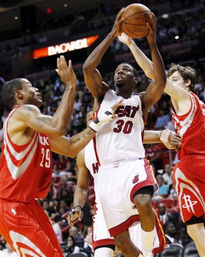 James, Heat win home finale over Houston, 97-88
