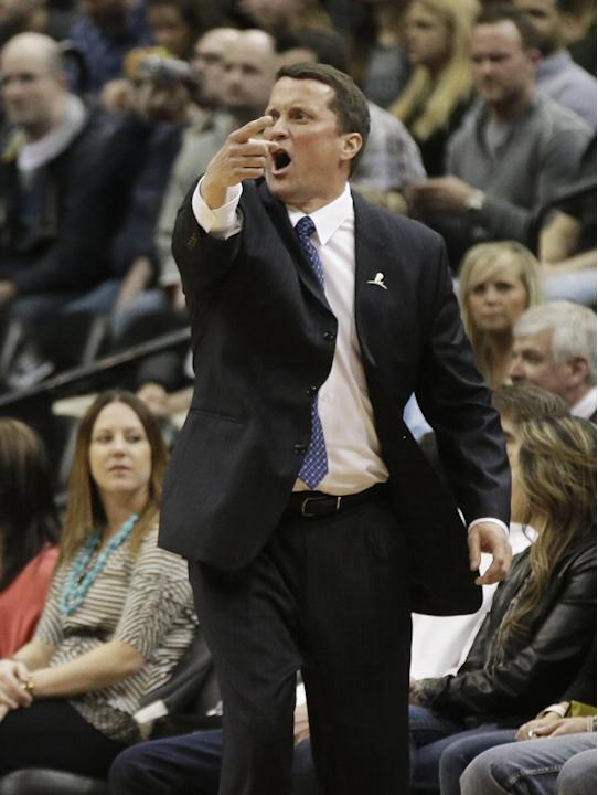 Detroit Pistons head coach John Loyer yells instructions in the first quarter of an NBA basketball game against the Minnesota Timberwolves, Friday, March 7, 2014, in Minneapolis