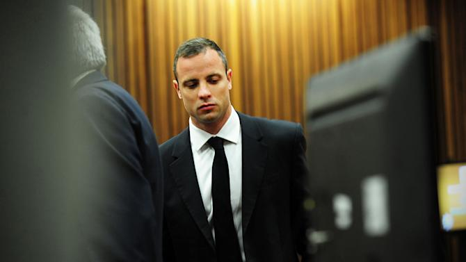 Oscar Pistorius arrives in court in Pretoria, South Africa, Wednesday, March 19, 2014. Pistorius is on trial for the murder of his girlfriend Reeva Steenkamp on Valentine's Day in 2013. (AP Photo/Leon Sadiki, Pool)
