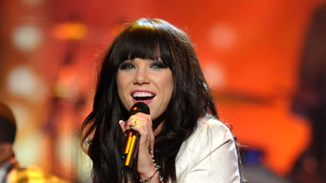 """FILE - This Nov. 18, 2012 file photo shows Carly Rae Jepsen performing at the 40th Annual American Music Awards in Los Angeles. The song put 27-year-old Jepsen, who finished third on a season of """"Canadian Idol,"""" in the spotlight and on a path to potential Grammy gold. The monster hit is nominated for song of the year and best pop vocal performance at the Feb. 10 awards show. (Photo by John Shearer/Invision/AP)"""