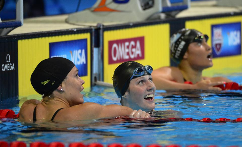 Natalie Coughlin, left, congratulates Missy Franklin after swimming in a women's 100-meter backstroke semifinal at the U.S. Olympic swimming trials, Tuesday, June 26, 2012, in Omaha, Neb. Franklin won the heat. (AP Photo/Mark J. Terrill)