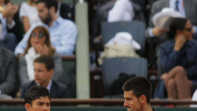 Serbia's Novak Djokovic reacts as he wins the second set against Switzerland's Roger Federer during their semifinal match in the French Open tennis tournament at the Roland Garros stadium in Paris, Friday, June 8, 2012.   (AP Photo/Michel Spingler)