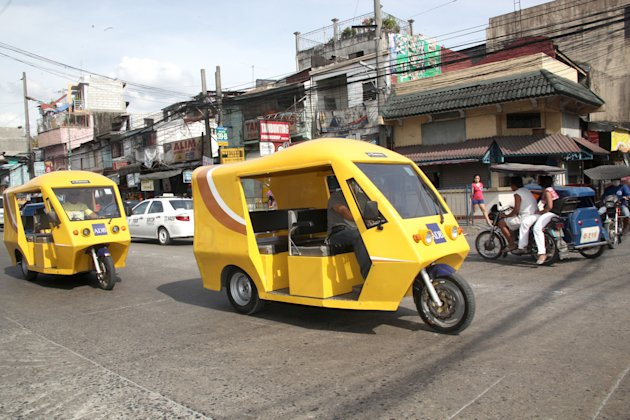 "Pinoys are seen to benefit from a ""green revolution"" with the Asian Development Bank's approval of a $300-million loan for the full rollout of the country's e-tricycle program. (Photo from the Asian Development Bank)"