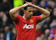 Manchester United's English defender Rio Ferdinand, pictured on April 22, trained as normal, amid British media reports of a showdown with coach Alex Ferguson over his refusal to wear an anti-racism T-shirt