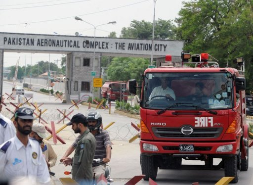 Pakistani firefighters leave the Minsas Air Force base after the completion of a commando operation against armed militants in Kamra on August 16, 2012.