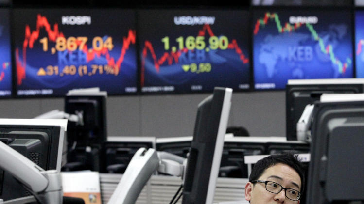 A currency trader works at the foreign exchange dealing room of the Korea Exchange Bank headquarters in Seoul, South Korea, Monday, June 11, 2012. South Korea's Kospi rose 1.71 percent, or 31.40 points, to close at 1,867.04. (AP Photo/Ahn Young-joon)