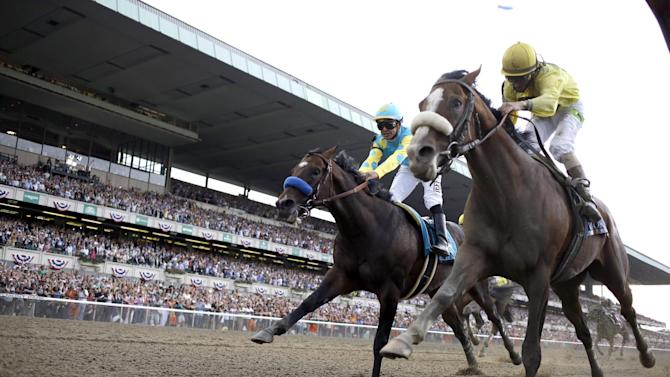 Jockey John Velazquez rides Union Rags, right, to victory over Paynter, with jockey Mike Smith, in the Belmont Stakes horse race in Elmont, N.Y., Saturday, June 9, 2012. (AP Photo/David J. Phillip)