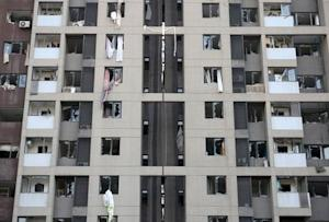 Broken windows are seen on a building where residents …