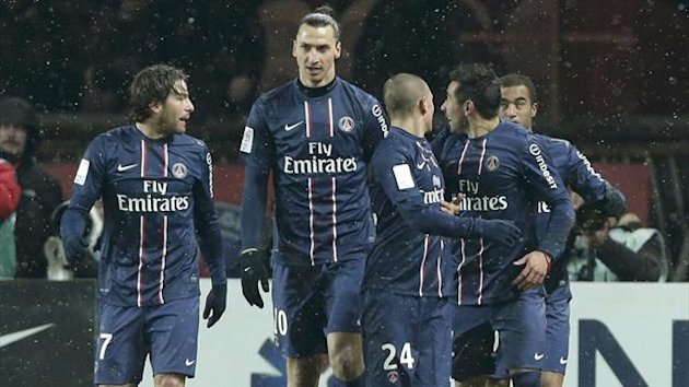 Paris Saint-Germain players, from L-C, Jeremy Menez, Zlatan Ibrahimovic, and Marco Verratti celebrate after a goal by Lucas against Olympic Marseille during their French Ligue 1 soccer match at Parc des Princes stadium in Paris February 24, 2013.