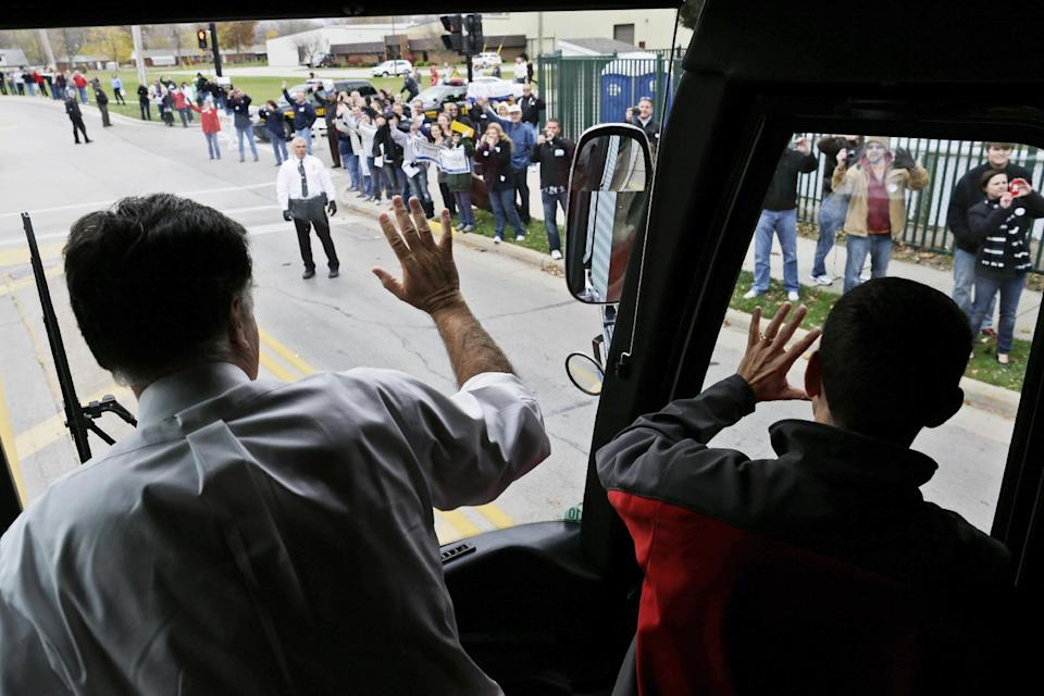 Republican presidential candidate and former Massachusetts Gov. Mitt Romney, left, and his vice presidential running mate Rep. Paul Ryan, R-Wis., wave from their campaign bus as it arrives in Celina, Ohio, for a campaign rally, Sunday, Oct. 28, 2012. (AP Photo/Charles Dharapak)