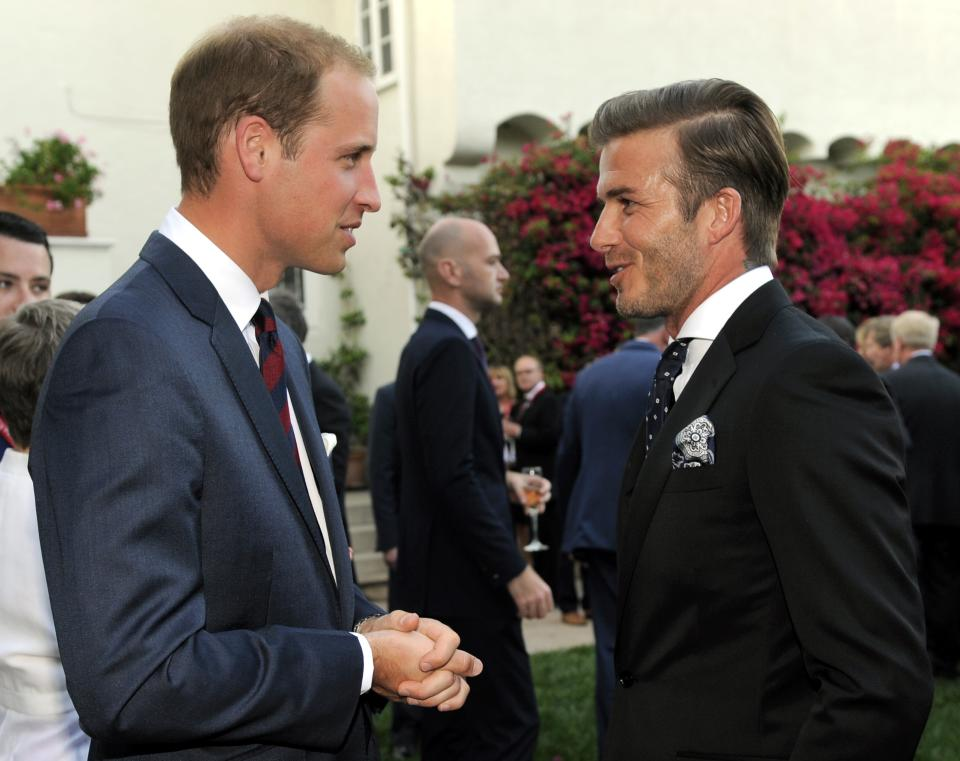 Prince William, Duke of Cambridge, mingles with soccer player David Beckham at a private reception at the British Consul-General's residence in Los Angeles, Friday, July 8, 2011. (AP Photo/Chris Pizzello, Pool)