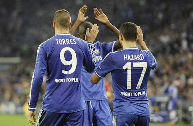 Chelsea's double scorer Fernando Torres, left, and his teammate Eden Hazard are congratulated by Ramires after Hazard scored their side's third goal during the Champions League group E soccer match be